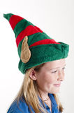 Elf hat  on girl Royalty Free Stock Images