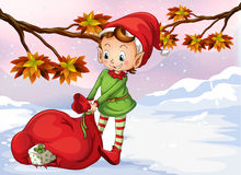 An elf holding a bag of gifts. Illustration of an elf holding a bag of gifts Stock Photo