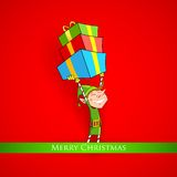 Elf holding Christmas gifts Royalty Free Stock Photos