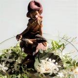 Elf between jasmines-Andalusia. Elf between jasmines -garden Stock Photo