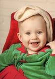 Elf kid in costume of santa. stock photography
