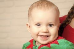 Elf kid in costume of santa. stock images