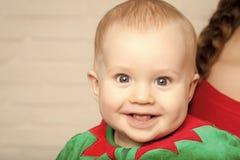 Elf kid in costume of santa. stock image