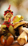Elf with mushrooms and autumnal fruits Stock Image