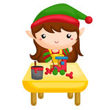 Elf painting a toys Stock Photography