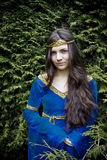 Elf princess  looking from bush Stock Photo