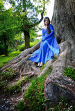Elf princess in roots of big tree royalty free stock photos