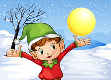 An elf raising his hand outside with snow Royalty Free Stock Photos