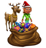 Elf and Reindeer with gift bag. On Christmas Royalty Free Stock Photography