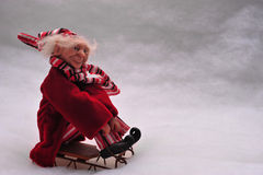 Elf riding sled Royalty Free Stock Image