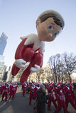 Elf on the Shelf flying through Macy's Parade Royalty Free Stock Images