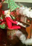 Elf on Shelf plays a tune Stock Photography