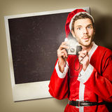 Elf taking christmas photo with santa Royalty Free Stock Photo