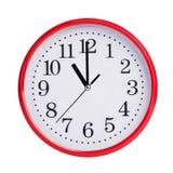 Elf Uhr auf einer runden Skala stockbild