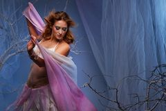 Elf woman dancing in magical forest. Elf in magical winter forest Royalty Free Stock Image