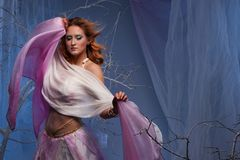 Elf woman dancing in magical forest. Elf in magical winter forest Royalty Free Stock Photography