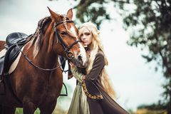 Elf woman in the forest with. A horse royalty free stock photography