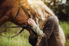 Elf woman in the forest with. A horse stock photography
