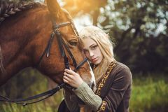 Elf woman in the forest with. A horse royalty free stock photos