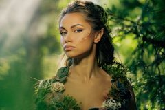 Elf woman in a forest. Elf woman in a magical forest Royalty Free Stock Photos