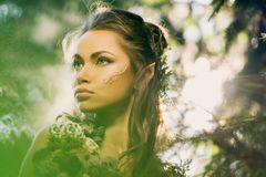 Elf woman in a forest. Elf woman in a magical forest Stock Images