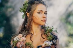 Elf woman in a forest Stock Photography
