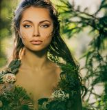 Elf woman in a forest stock photo