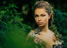 Elf woman in a forest. Elf woman in a magical forest Stock Photos