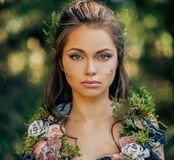 Elf woman in a forest. Elf woman in a magical forest Royalty Free Stock Photo