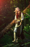 Elf From The Woods. Elf holding a bow with an arrow royalty free stock photography