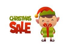 Elfe mignon heureux de bande dessinée avec le présent de cadeau et la vente de Noël des textes photos stock