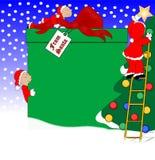 Elfes décorant pour Noël Photos libres de droits