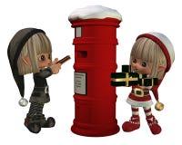 Elfes de Noël - présents de signalisation Photographie stock libre de droits