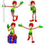 Elfi che ballano intorno al regalo Fotografia Stock Libera da Diritti