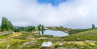 Elfin  lakes in foggy. Elfin Lakes are two lakes in Garibaldi Provincial Park that are popular for hiking, snowshoeing, skiing, and mountain bicycling trail Royalty Free Stock Images