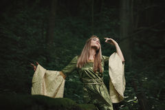 Elfin queen dancing in the woods Stock Images