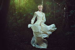 Elfin woman dancing in fairy forest Royalty Free Stock Photos