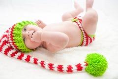 Elfish Christmas Baby Stock Photo