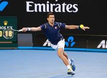Elfmal Grand Slam-Meister Novak Djokovic von Serbien in der Aktion während seines Australian Open-Viertelfinalematches 2016 Lizenzfreies Stockbild