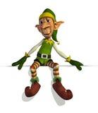 Elfo delle Santa che si siede sul bordo Fotografie Stock
