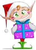 Elfo di natale che tiene un presente Immagine Stock