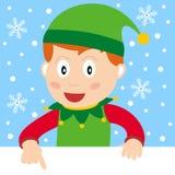 Elfo di natale con la bandiera in bianco Fotografia Stock