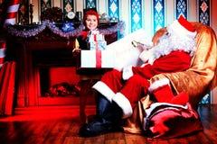 Elfo e Santa immagine stock