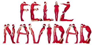 Elfs forming the phrase FELIZ NAVIDAD Stock Photos