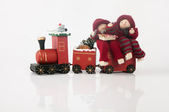 Elfs on a toy train. Two christmas on a toy train, white background Stock Photo
