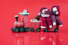 Elfs on train. Two christmas elfs on a toy train Royalty Free Stock Photo