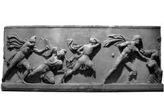 Elgin Marbles. Section of the Elgin Marbles depicting battling ancient greek warriors Stock Image