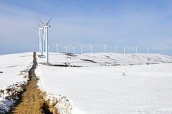 Elguea range with wind turbines farm in winter Royalty Free Stock Image