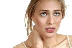 Woman with sore neck. Portrait of young woman with severe neck pain Stock Photos