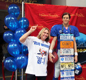 Eli Manning At Madame Tussauds. Super fan Joe Ruback,a.k.a License Plate Guy, shares his trademark Giants-themed license plate necklace with the wax figure of Royalty Free Stock Photo